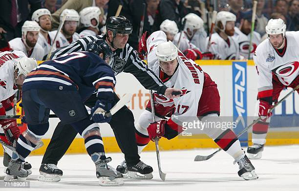 Referee Greg Devorski drops the puck for a face between Shawn Horcoff of the Edmonton Oilers and Rod Brind'Amour of the Carolina Hurricanes during...