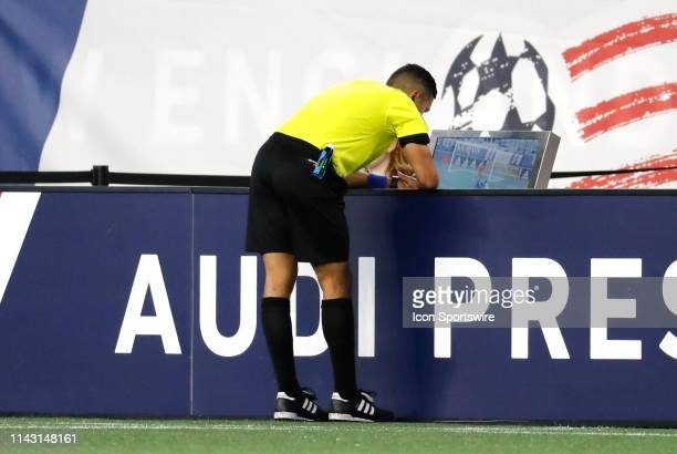 Referee Guido Gonzalez Jr goes to the VAR during a match between the New England Revolution and the San Jose Earthquakes on May 11 at Gillette...