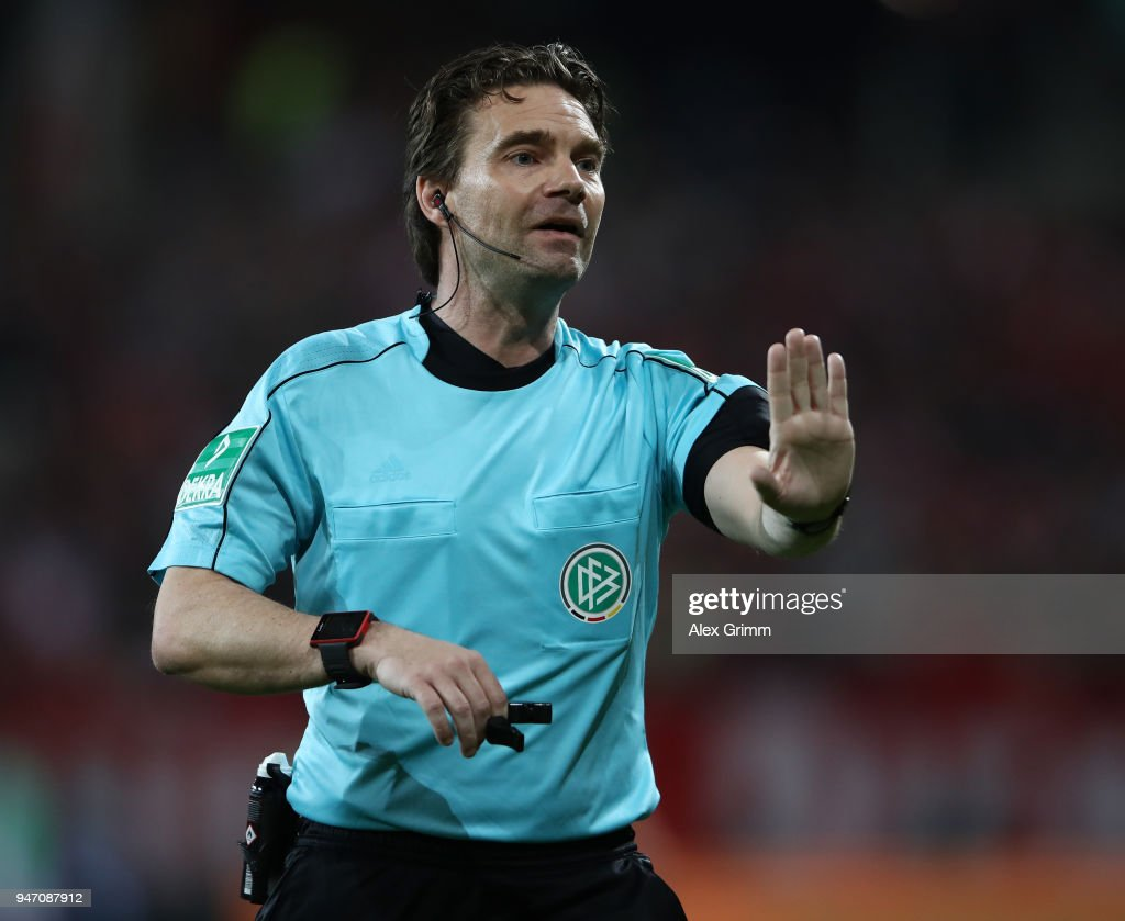 Referee Guido Winkmann gestures during the Bundesliga match between 1. FSV Mainz 05 and Sport-Club Freiburg at Opel Arena on April 16, 2018 in Mainz, Germany.