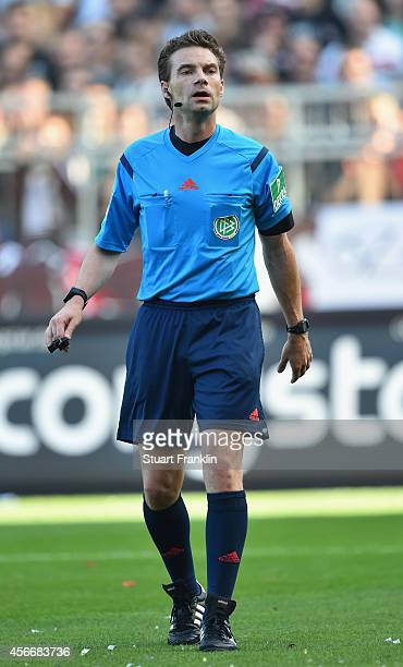 Referee Guido Winkmann looks on during the Second Bundesliga match between FC St Pauli and 1 FC Union Berlin at Millerntor Stadium on October 4 2014...