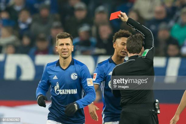 Referee Guido Winkmann shows a yellow red card to Matija Nastasic of Schalke during the Bundesliga match between FC Schalke 04 and SV Werder Bremen...