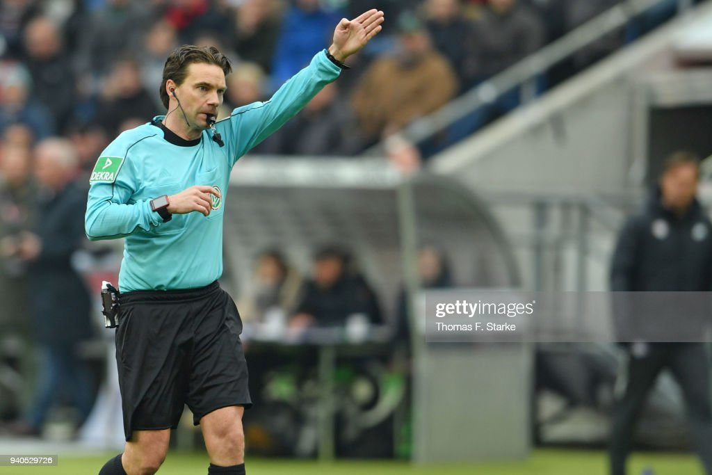 Referee Guido Winkmann whistles during the Bundesliga match between Hannover 96 and RB Leipzig at HDI-Arena on March 31, 2018 in Hanover, Germany.