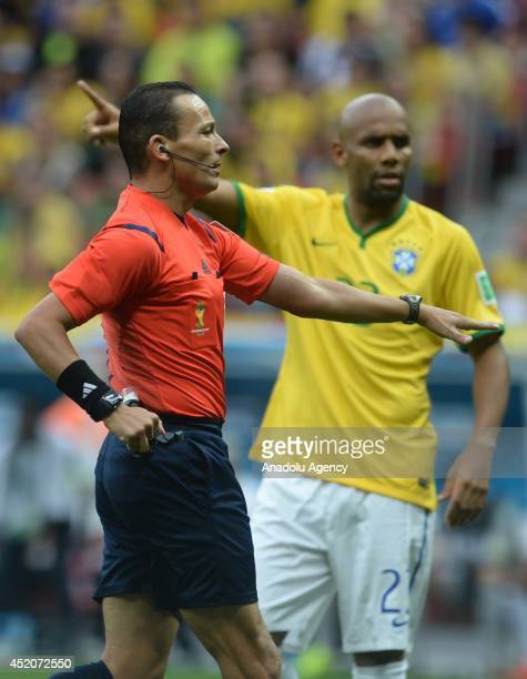 Referee Haimoudi Djamel gestures during the 2014 FIFA World Cup Brazil Third Place Playoff match between Brazil and the Netherlands at Estadio...