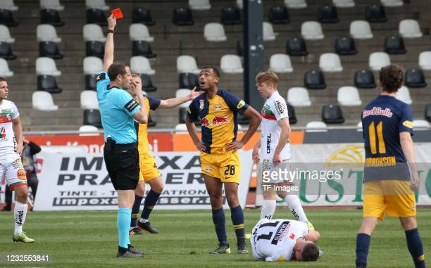 Referee Harald Lechner, Antoine Bernede of Red Bull Salzburg gets the red card during the tipico Bundesliga match between Wolfsberger AC and RB...