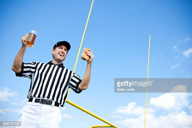 referee: having a beer and sandwich - american football judge stock pictures, royalty-free photos & images