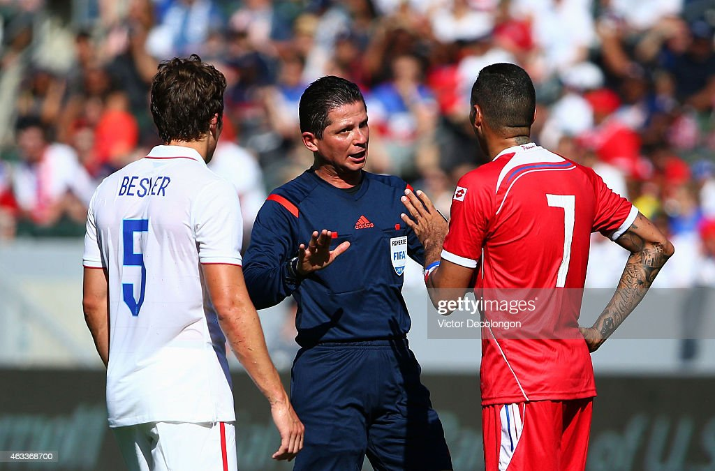 Referee Henry Bejarano explains the call to Blas Perez #7 of Panama as Matt Besler #7 of the USA looks on during the international men's friendly match at StubHub Center on February 8, 2015 in Los Angeles, California. The USA defeated Panama 2-0.