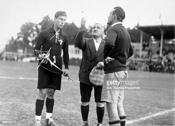 Referee Henry Cristophe tossing the coin watched by Mexican captain Rafael Gutierrez and Chile's Carlos Schenerberger prior to their FIFA World Cup...