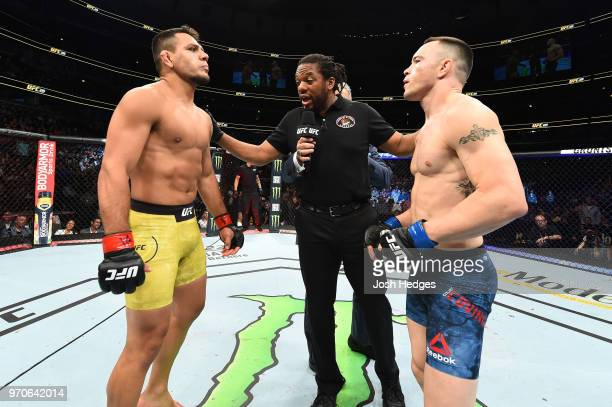 Referee Herb Dean instructs Rafael Dos Anjos of Brazil and Colby Covington prior to their interim welterweight title fight during the UFC 225 event...