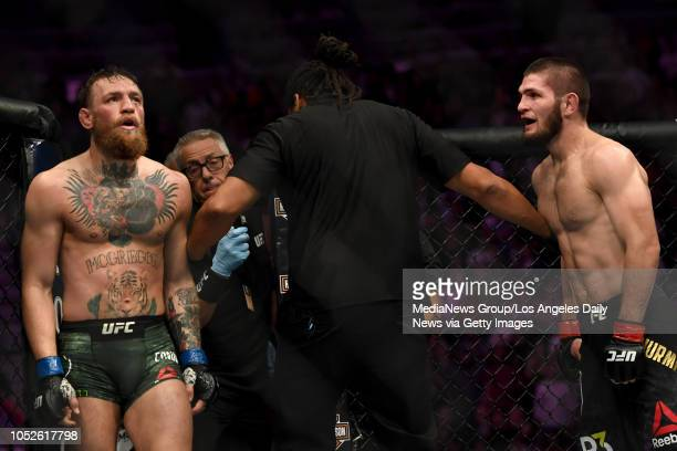 Referee Herb Dean separates Conor McGregor left and Khabib Nurmagomedov during their fight at UFC 229 at the TMobile Arena in Las Vegas Nev Friday...