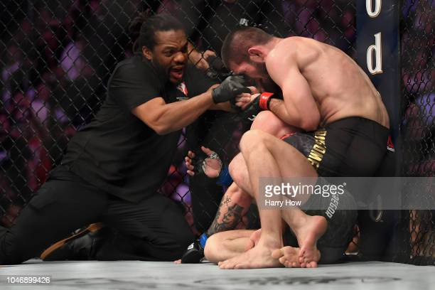 Referee Herb Dean separates Khabib Nurmagomedov of Russia from Conor McGregor of Ireland after McGregor tapped out in their UFC lightweight...