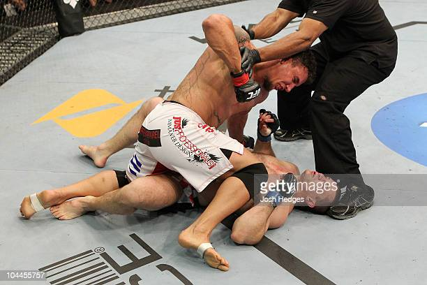 Referee Herb Dean stops the fight after Mirko Cro Cop is knocked out by a knee from Frank Mir during their UFC heavyweight bout at Conseco Fieldhouse...