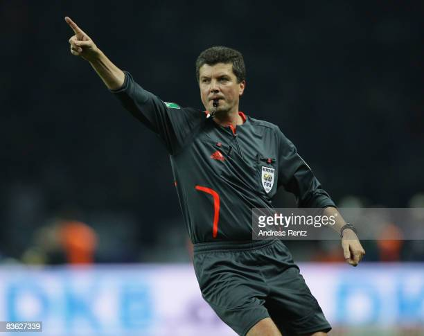 Referee Herbert Fandel gives instructions during the Bundesliga match between Hertha BSC Berlin and 1899 Hoffenheim at the Olympic stadium on...