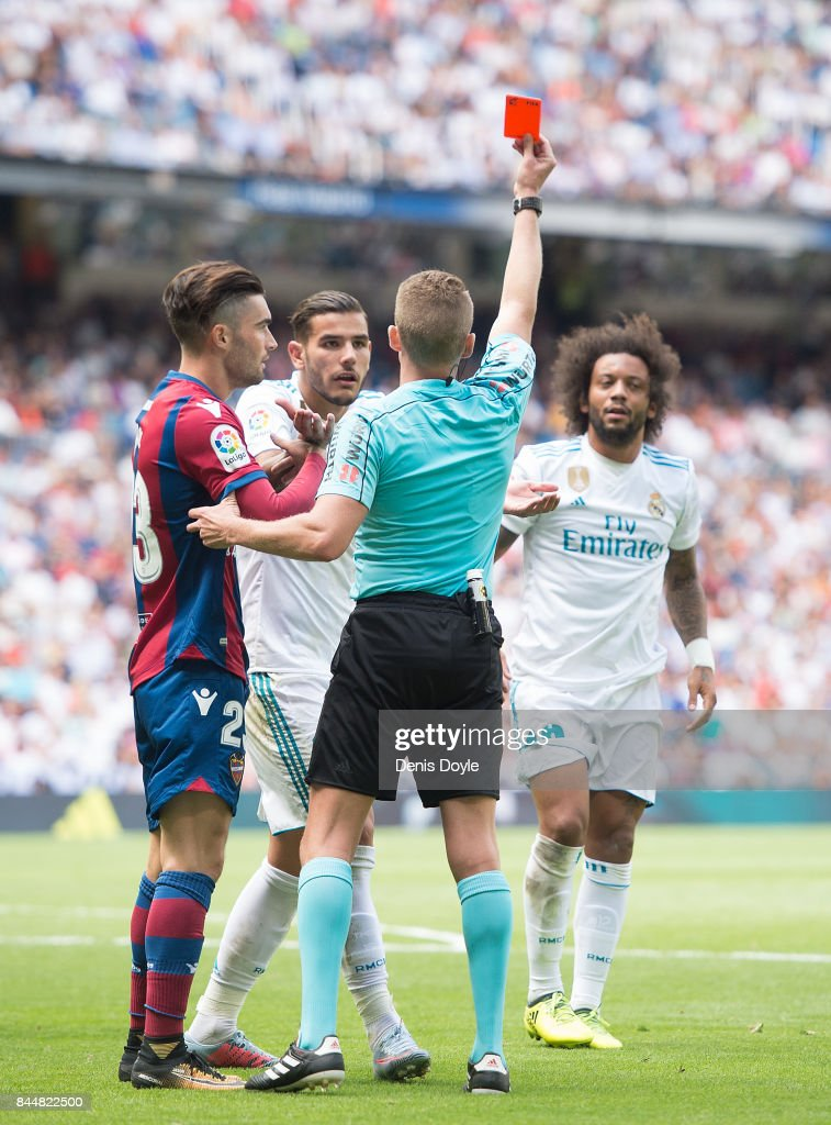 Referee Hernandez Hernandez shows the red card to send off Marcelo of Real Madrid during the La Liga match between Real Madrid and Levante at Estadio Santiago Bernabeu on September 9, 2017 in Madrid, .