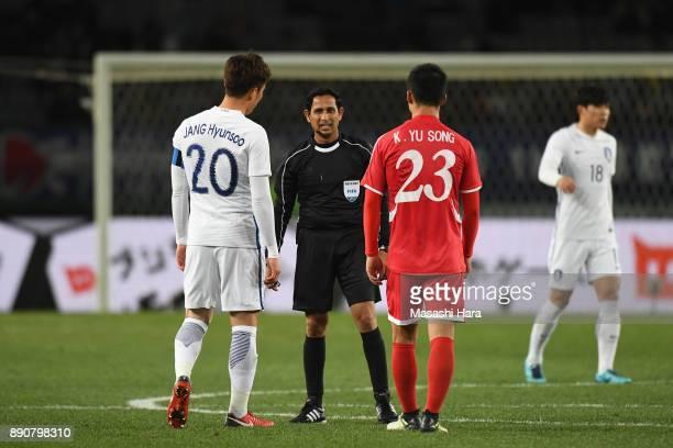 Referee Hettikamkanamge Perera talks to Jang Hyunsoo of South Korea and Kim Yu Song of North Korea during the EAFF E1 Men's Football Championship...
