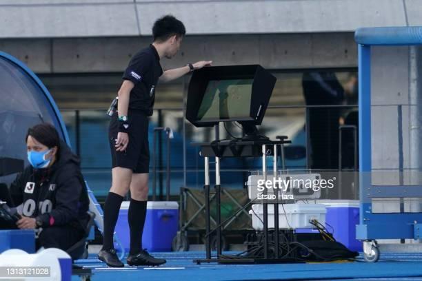 Referee Hiroki Kasahara watches the VAR monitor during the J.League Meiji Yasuda J1 match between Kawasaki Frontale and Sanfrecce Hiroshima at...
