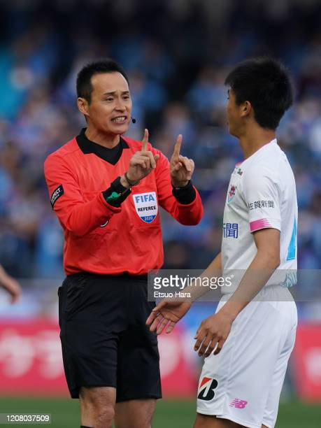 Referee Hiroyuki Kimura gestures during the JLeague MEIJI YASUDA J1 match between Kawasaki Frontale and Sagan Tosu at Todoroki Stadium on February 22...