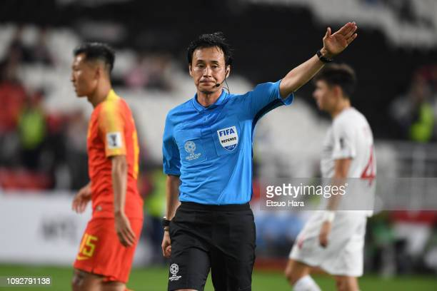 Referee Hiroyuki Kimura of Japan gestures during the AFC Asian Cup Group C match between the Philippines and China at Mohammed Bin Zayed Stadium on...