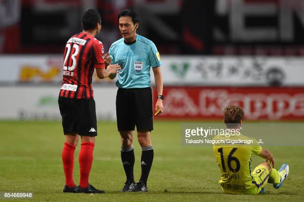 Referee Hiroyuki Kimura talks to Macedo of Consadole Sapporo pefore showing a yellow card by during the JLeague J1 match between Consadole Sapporo...