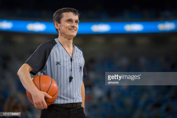 referee holding basketball - referee stock pictures, royalty-free photos & images