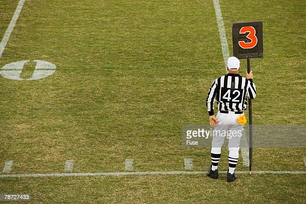 referee holding down marker - american football referee stock pictures, royalty-free photos & images