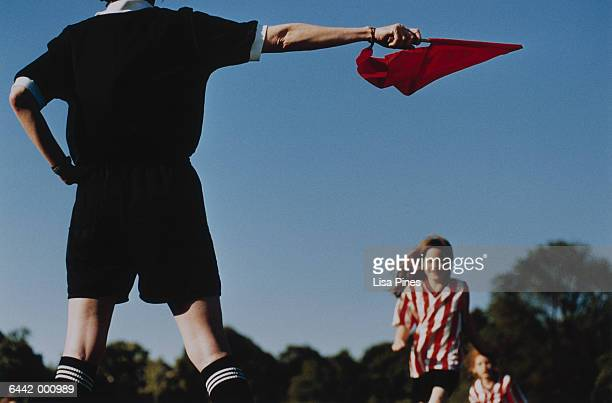 Referee Holding Red Flag