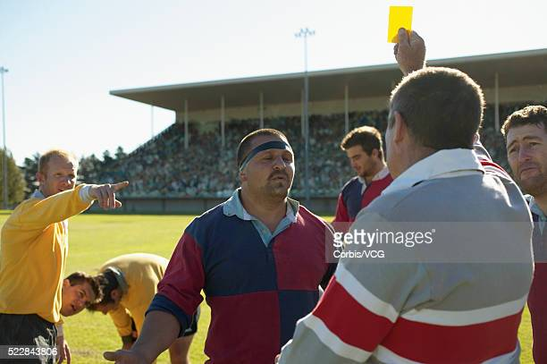 referee holding up a yellow card to a rugby player - yellow card sport symbol stock pictures, royalty-free photos & images