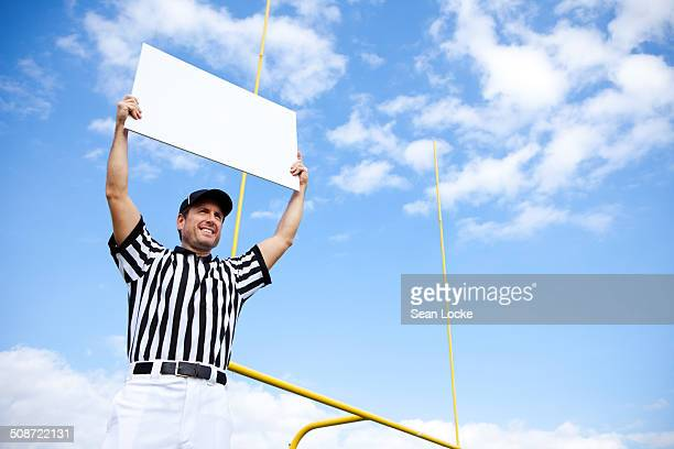 referee: holding up blank sign by goal posts - american football judge stock pictures, royalty-free photos & images