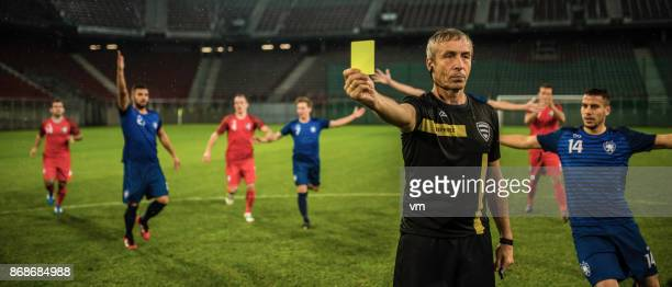 referee holding yellow card - yellow card stock pictures, royalty-free photos & images