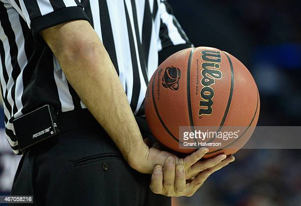 A referee holds a basketball as he waits for the Belmont Bruins against Virginia Cavaliers during the second round of the 2015 NCAA Men's Basketball...