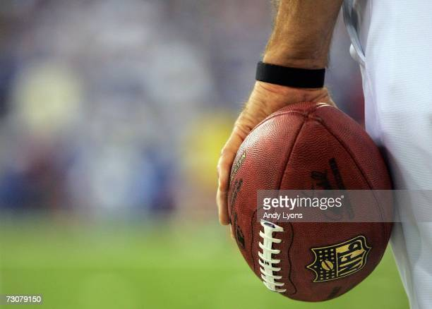 A referee holds a football during the AFC Championship Game between the Indianapolis Colts and the New England Patriots on January 21 2007 at the RCA...