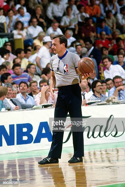 A referee holds the ball during the 1987 NBA Finals between the Los Angeles Lakers and the Boston Celtics at the Boston Garden in Boston...