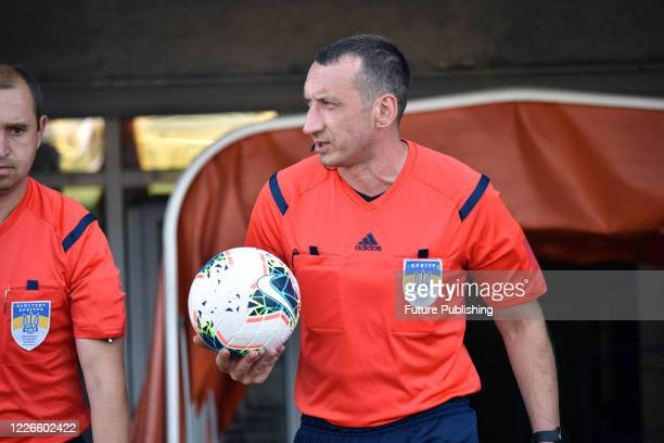 Referee holds the ball during the Ukrainian Premier League Matchday 30 game between FC Mariupol and FC Olimpik Donetsk in Mariupol, Donetsk Region,...