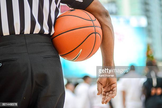 A referee holds the game ball during a timeout in the first half of the game against the San Diego State Aztecs and the University of San Diego...
