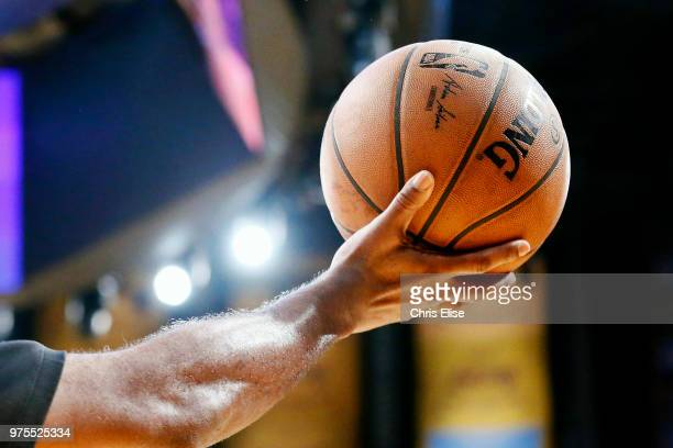 A referee holds the official game ball during the game between the Sacramento Kings and the Los Angeles Lakers on January 9 2018 at STAPLES Center in...
