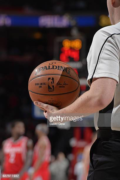 A referee holds the Official NBA Spalding Basketball during the Houston Rockets game against the Philadelphia 76ers at Wells Fargo Center on January...