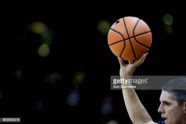 A referee holds up a basketball along the sidelines during a regular season PAC12 basketball game featuring Colorado and Arizona on January 06 2018...