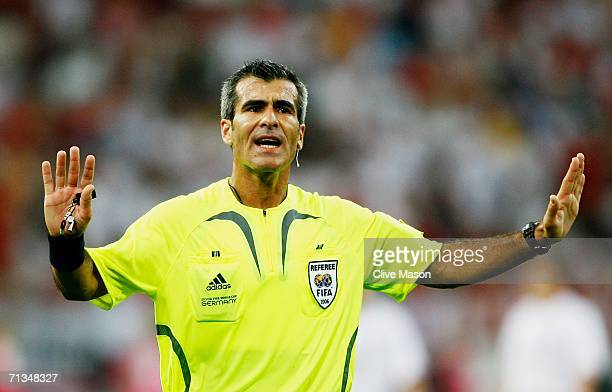 Referee Horacio Elizondo of Argentina gestures during the FIFA World Cup Germany 2006 Quarterfinal match between England and Portugal played at the...