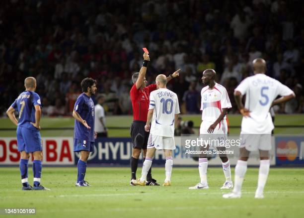 Referee Horacio Marcelo Elizozondo shows the red card to Zinedine Zidane of France afetr he head butted Marco Materazzi of Italy during the World Cup...