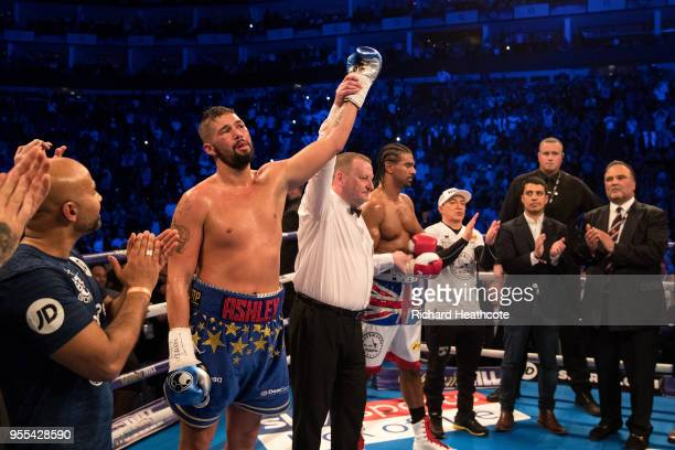 Referee Howard Foster raises Tony Bellews hand to signal his victory during the Heavyweight contest between Tony Bellew and David Haye at The O2...