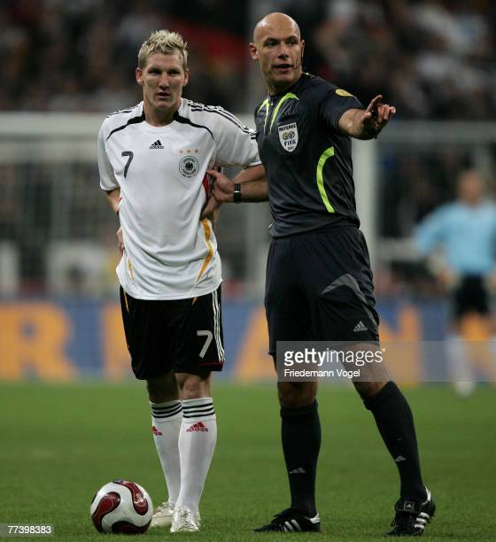 Referee Howard Melton Webb gives advise to Bastian Schweinsteiger of Germany in action during the UEFA Euro 2008 Group D qualifying match between...