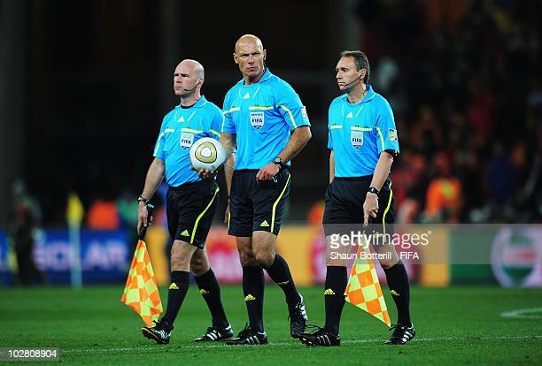 Referee Howard Webb and assistants Darren Cann and Michael Mullarrkey leave the field at half time during the 2010 FIFA World Cup South Africa Final...