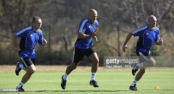 Referee Howard Webb and his assitants Darren Cann and Michael Mullarkey warm up during a training session at the Final Referees Media Day for the...