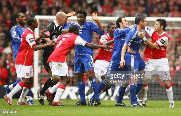 Referee Howard Webb attempts to difuse a brawl between the Arsenal and Chelsea players during the Carling Cup Final match between Chelsea and Arsenal...