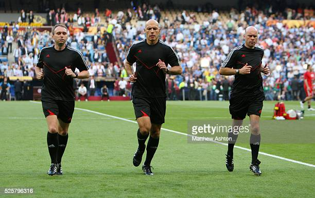 Referee Howard Webb from England and Assistant referees Mike Mullarkey and Darren Cann | Location Madrid Spain