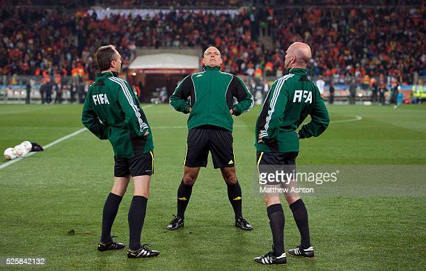 Referee Howard Webb from England and his assistant referee's Darren Cann and Michael Mullarkey warm up before the game