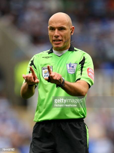 Referee Howard Webb in action during the Barclays Premier League match between Reading and West Ham United at the Madejski Stadium on September 1,...