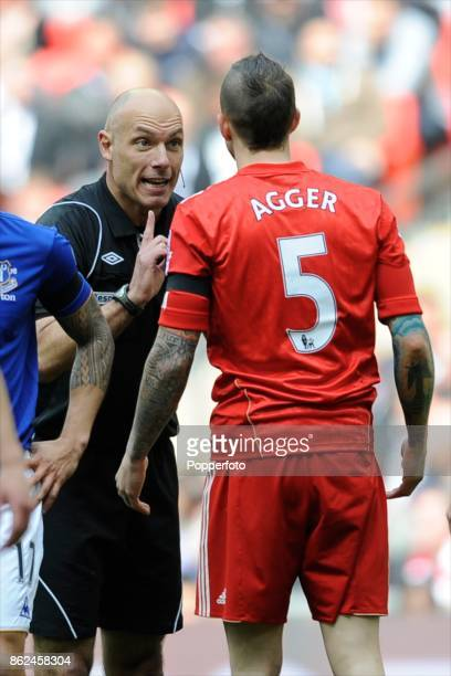 Referee Howard Webb in conversation with Daniel Agger of Liverpool during the FA Cup Semi Final match between Liverpool and Everton at Wembley...