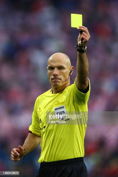 Referee Howard Webb issues a yellow card during the UEFA EURO 2012 group C match between Italy and Croatia at The Municipal Stadium on June 14, 2012...
