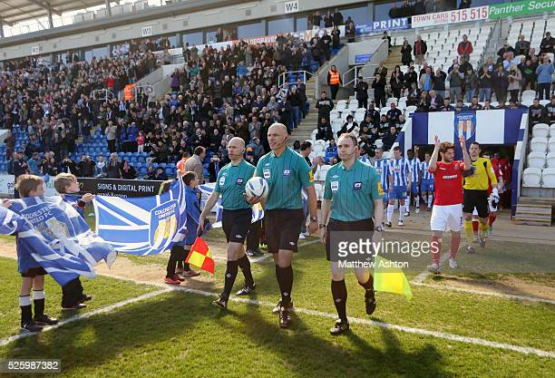 Referee Howard Webb leads out the Colchester United and Shrewsbury Town teams along with Assistants Mike Mullarkey and Darren Cann