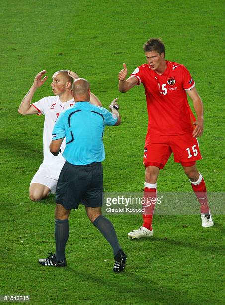 Referee Howard Webb of England signals a penalty in the final minute during the UEFA EURO 2008 Group B match between Austria and Poland at Ernst...